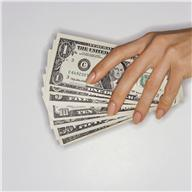 Hand Holding Paper Currency ca. 2002